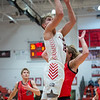 New Albany junior Maddox Schmelz drives in for a lay-up during the Bulldogs' 71-70 loss to Blackford at the Doghouse on Tuesday. Photo by Joe Ullrich