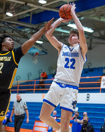 Charlestown junior Chase Benner shoots a shot during the Pirates' 75-61 loss to Clarksville in the 60th Annual Holiday tournament held at Silver Creek on Tuesday. Photo by Joe Ullrich