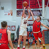 New Albany junior Tucker Biven puts up a shot during the Bulldogs' 71-70 loss to Blackford at the Doghouse on Tuesday. Photo by Joe Ullrich
