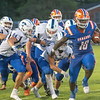 Silver Creek junior LaShun Mays, Jr. drives away from the defense during the Dragons' 39-14 victory over Charlestown on Friday. Photo by Joe Ullrich