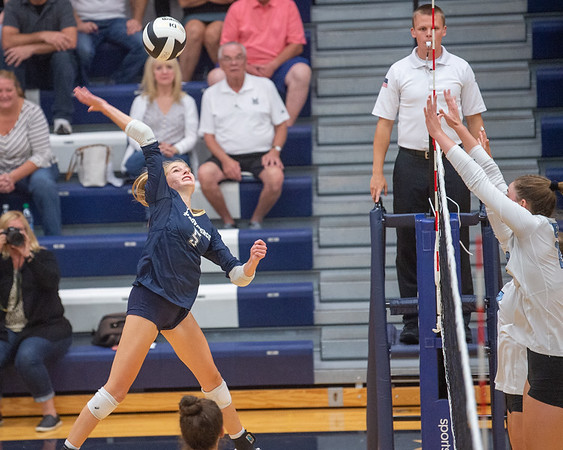 Providence sophomore Lilly Kaiser attempts a kill during the Pioneers' straight set loss to visiting Mercy on Tuesday. Photo by Joe Ullrich