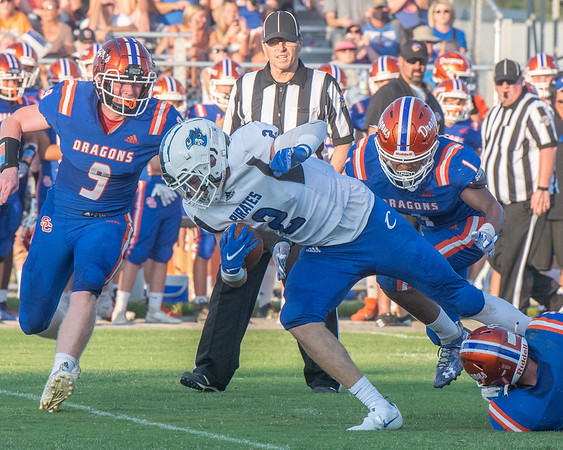 Charlestown senior Chase Benner fights for yardage during the Pirates' 39-14 loss at Silver Creek on Friday. Photo by Joe Ullrich