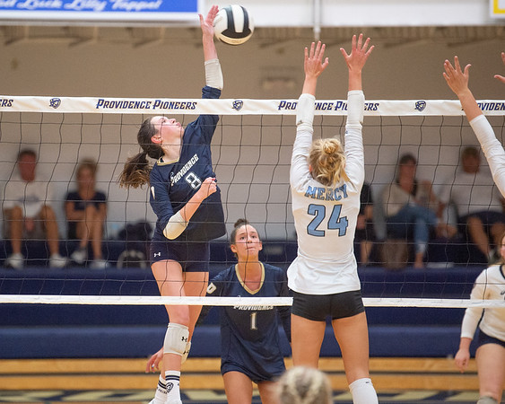 Providence sophomore Makenzie Wagner drives a kill attempt during the Pioneers' straight set loss to visiting Mercy on Tuesday. Photo by Joe Ullrich