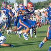 Silver Creek senior Trey Schoen leaps for extra yardage during the Dragons' 39-14 victory over Charlestown on Friday. Photo by Joe Ullrich