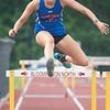 Silver Creek senior Natalie Day jumps a hurdle in the 300-meter hurdles at the Bloomington North regional championship on Tuesday. Photo by Joe Ullrich