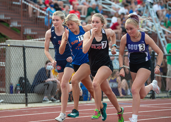 Silver Creek's Kenzie Wesley (11) starts the 800-meter run during the Bloomington North regional championship on Tuesday. Photo by Joe Ullrich
