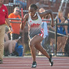 Jeffersonville's Ahmya Baker starts the 4x100-meter relay for the Red Devil's at the Bloomington North regional championship on Tuesday. Photo by Joe Ullrich