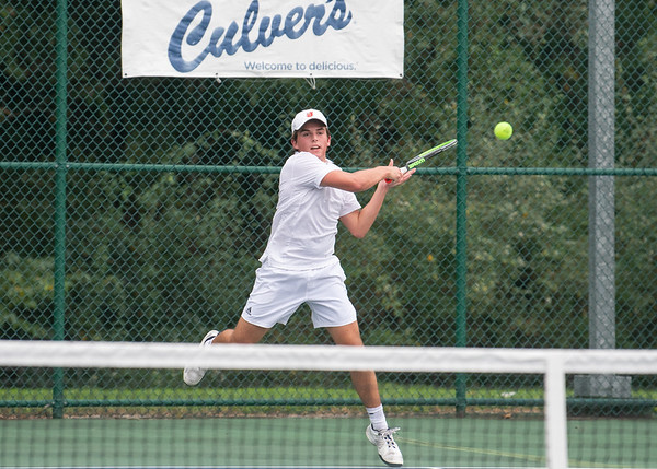 Jeffersonville's Max Fishers smashes a forehand hit during the Red Devil's weather delayed Regional Championship against Floyd Central on Wednesday. Photo by Joe Ullrich
