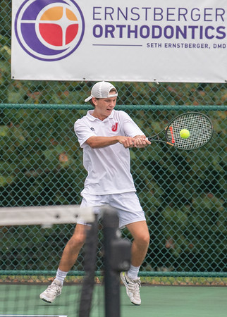 Jeffersonville's Alex Kelley returns a forehand smash during the Red Devil's weather delayed Regional Championship against Floyd Central on Wednesday. Photo by Joe Ullrich