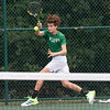 Floyd Central's Benjamin Lammert runs down a ball during the Highlander's weather delayed Regional Championship against Jeffersonville on Wednesday. Photo by Joe Ullrich