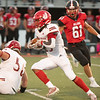 Jeffersonville Davarhy Julian carries the ball during the Red Devils' 41-19 loss Hoosier Hills Conference rival New Albany on Friday. Photo by Joe Ullrich