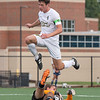 Floyd Central  captain Byron Clark leaps over goalkeeper William Smith during the Highlanders' 2-1 victory over Seymour in their Class 3A New Albany Sectional game on Tuesday. Photo by Joe Ullrich