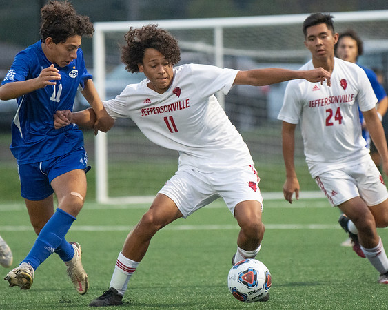 Jeffersonville junior junior Donovan Krabbe fight for the ball during the Red Devils' 4-0 loss to Columbus North in their Class 3A New Albany Sectional game on Tuesday. Photo by Joe Ullrich