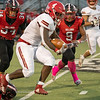 Jeffersonville junior Zion Mansfield leaps forward for extra yardage during the Red Devils' 41-19 loss Hoosier Hills Conference rival New Albany on Friday. Photo by Joe Ullrich