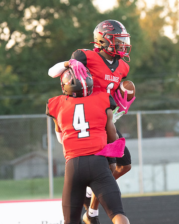 New Albany seniors Dejon Winburn (4) and Daquan High celebrate in the end zone during the Bulldogs' 41-19 victory over Hoosier Hills Conference rival Jeffersonville on Friday. Photo by Joe Ullrich