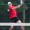 Borden's AJ Agnew returns a serve during the Braves'  weather delayed Regional Championship individual doubles match against Salem on Wednesday. Photo by Joe Ullrich