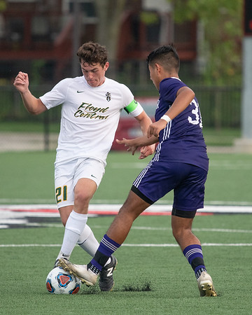 Floyd Central junior Bryce Johnson battles for control of the ball during the Highlanders' 2-1 victory over Seymour in their Class 3A New Albany Sectional game on Tuesday. Photo by Joe Ullrich