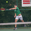 Floyd Central's Isaac Anderson smashes a ball during his No. 1 singles match with Alex Kelley during the Highlander's weather delayed Regional Championship against Jeffersonville on Wednesday. Photo by Joe Ullrich