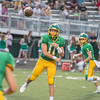 Floyd Central junior quarterback Cody Bibelhauser throws out of the backfield during the Highlanders' game against Silver Creek on Friday. Photo by Joe Ullrich