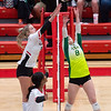 Floyd Central junior Mandy Hess jousts New Albany junior Alexis Caldwell during the Highlanders' 3-0 straight set victory at New Albany on Thursday. Photo by Joe Ullrich