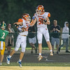 Silver Creek's Trey Schoen celebrates with James Kearney (51) after scoring during the Dragons' 26-0 victory at Floyd Central on Friday. Photo by Joe Ullrich