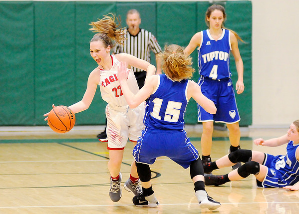 Don Knight | The Herald Bulletin<br /> Frankton's Sierra Southard brings the ball down court after grabbing a loose ball as the Eagles faced Tipton in the first round of the regional at Eastern High School on Saturday.
