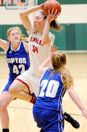 Don Knight | The Herald Bulletin<br /> Frankton's Destyne Knight drives to the basket between Tipton's Rachel Majors, left, and Kelsey Mitchell in the first round of the regional at Eastern High School on Saturday.