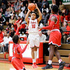 Don Knight |  The Herald Bulletin<br /> Anderson's Joseph Jones sinks a three-point basket as he is double teamed by  Richmond on Thursday.