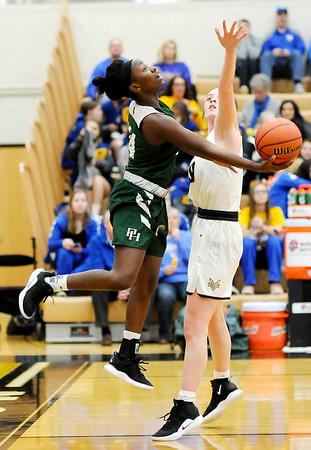 Don Knight   The Herald Bulletin<br /> Pendleton Heights Leonie Wilson drives the baseline as the Arabians faced Mt. Vernon  in the sectional semifinal on Friday.
