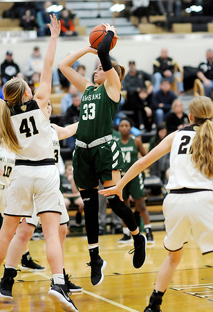 Don Knight   The Herald Bulletin<br /> Pendleton Heights' Megan Mills shoots as the Arabians faced Mt. Vernon in the sectional semifinal on Friday.
