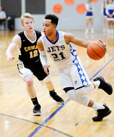 Don Knight | The Herald Bulletin<br /> APA's Lanson Jones drives as he is guarded by Cowan's Declan Gill on Tuesday.