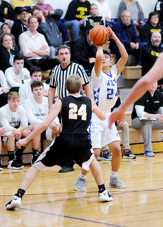 Don Knight | The Herald Bulletin<br /> APA's Larry Rodriguez releases a three-point shot as he is guarded by Cowan's Jacob Thomas on Tuesday.