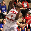 Chris Martin | For The Herald Bulletin<br /> Liberty Christian's Monica Watkins drives in for a lay up Saturday morning in a Regional loss to Union City.