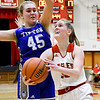 Frankton's Lauryn Bates drives past Ashley Schram of Tipton as she goes up for shot.