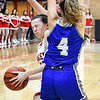 Frankton's Bailee Webb gets sandwiched by Tipton defenders as she tries to drive the lane.