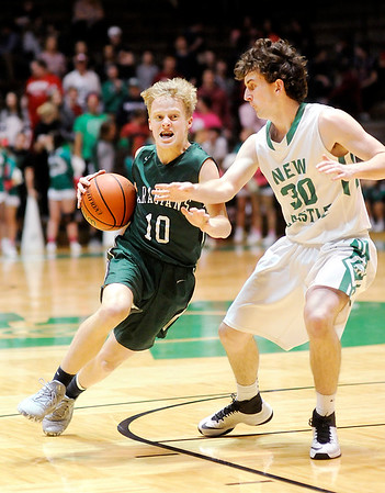 Don Knight | The Herald Bulletin<br /> Pendleton Heights' Karsten Windlan drives to the basket as he is guarded by New Castle's Garrett Welch on Tuesday.