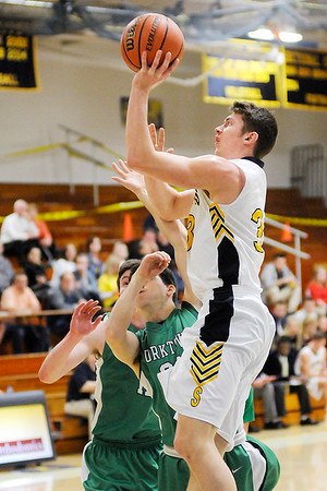 Don Knight | The Herald Bulletin<br /> Shenandoah's Gavin Griggs shoots over Yorktown's Brevin Smith on Wednesday.