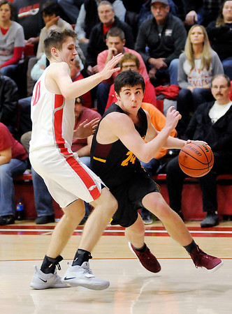 Don Knight   The Herald Bulletin<br /> Alexandria's Rylan Metz drives as he is guarded by Frankton's Rylan Detling as the Eagles hosted the Tigers on Friday.