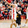 Don Knight | The Herald Bulletin<br /> Frankton's Kayden Key scores a layup as he is guarded by Alexandria's Trey Stokes on Friday.