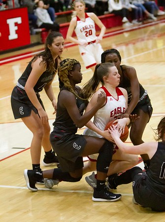 Bob Hickey | For The Herald Bulletin<br /> Frankton's Bailey Webb fights to get control of a loose ball as she is surrounded by a group of Eastbrook defenders