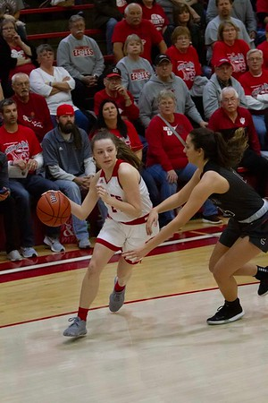 Bob Hickey | For The Herald Bulletin<br /> Frankton's Bailey Webb drives around an Eastbrook defender during game one of Saturday's Regional playoff
