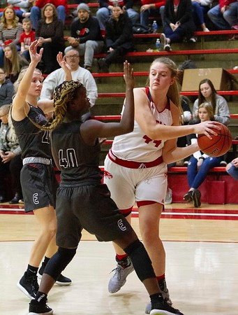 Bob Hickey   For The Herald Bulletin<br /> Chloe Thomas gets trapped at the baseline and looks to pass the ball during game one of Saturday's Regional play