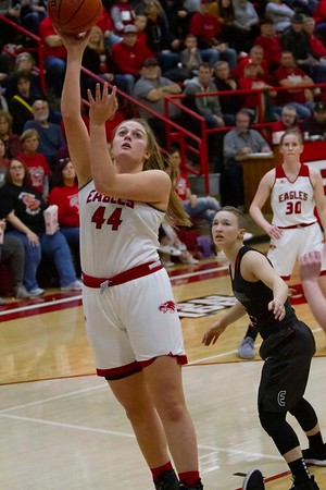 Bob Hickey | For The Herald Bulletin<br /> Frankton's Chloe Thomas drives to the basket Saturday as the Eagles played the Eastbrook Panthers in game one of Regional play