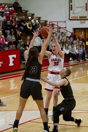 Bob Hickey | For The Herald Bulletin<br /> Frankton's Lauryn Bates drives to the basket as Eastbrooks Alexis Binkerd stands in her way