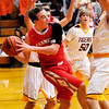 Don Knight | The Herald Bulletin<br /> Frankton's Travis McGuire looks to pass after drawing the Alexandria defense as the Tigers hosted the Eagles on Friday.