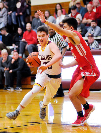 Don Knight | The Herald Bulletin<br /> Alexandria Brennan Morehead drives into the lane as he is guarded by Frankton's Jon Hatzell on Friday.