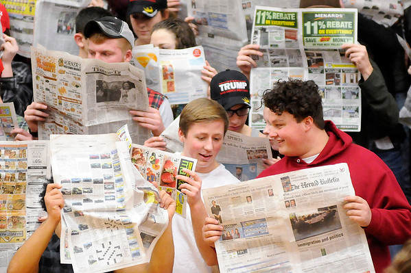 Don Knight | The Herald Bulletin<br /> Alexandria students show their disinterest in Frankton's starting five by pretending to read the newspaper as the Tigers hosted the Eagles on Friday.