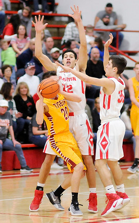 Don Knight   The Herald Bulletin<br /> Frankton's Maurice Knight and Kayden Key trap Blake Morehead at halfcourt forcing Alexandria to use a timeout on Friday.