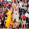 Don Knight | The Herald Bulletin<br /> Frankton's Patrick Spillman draws a foul from Alexandria's Miller Abernathy on a drive to the basket on Friday.