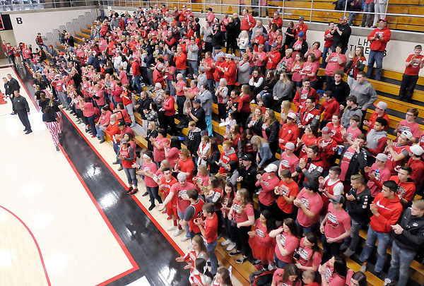 Don Knight | The Herald Bulletin<br /> Frankton fans stand as the Eagles run onto the court for their warm up before the  semi-state at Logansport on Saturday.